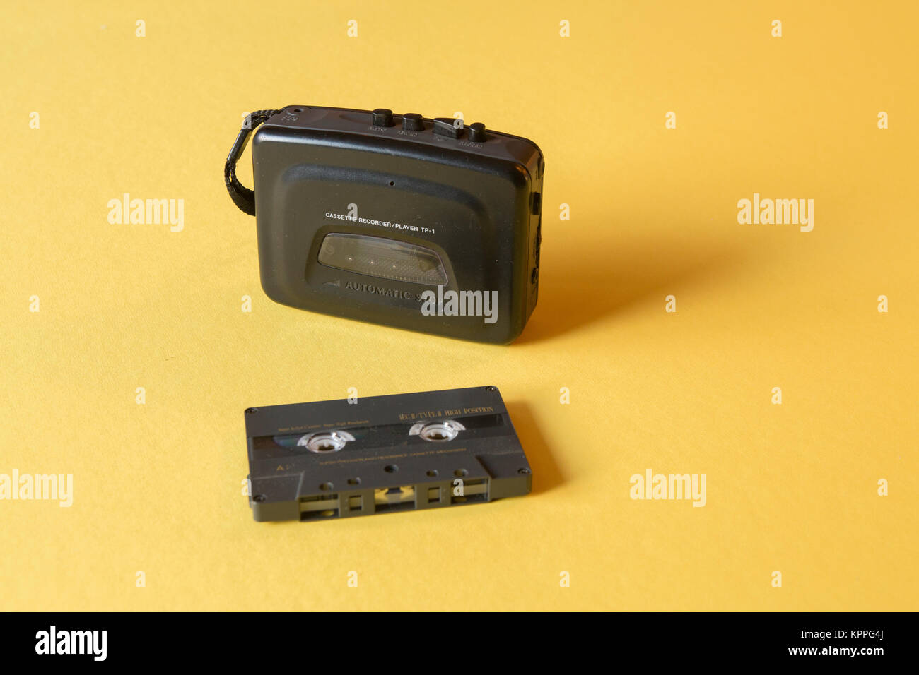 old-fashioned music cassette and walkman - Stock Image