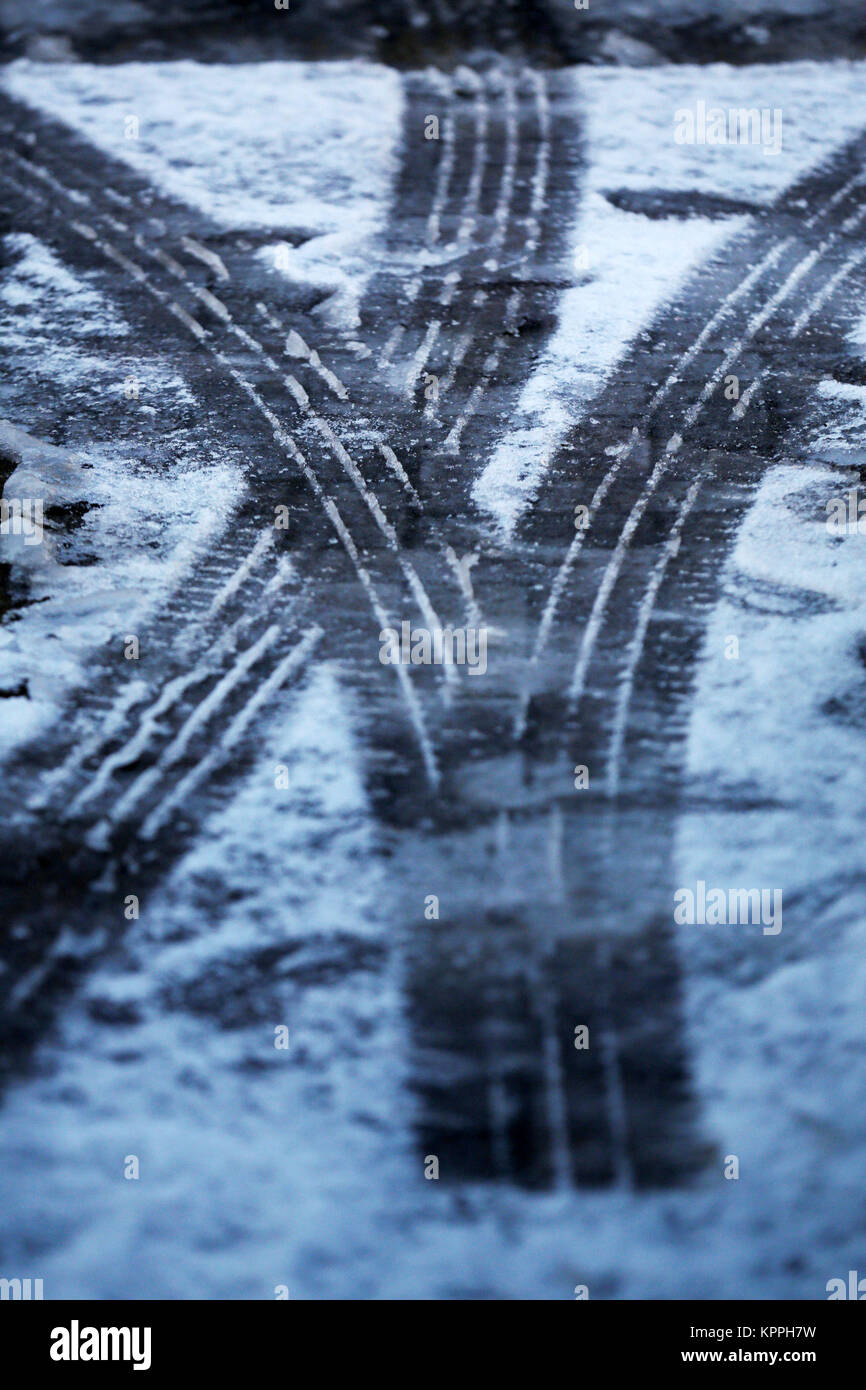Tyre tracks in the Scottish Borders, as fresh warnings for ice have been issued for parts of Scotland as the cold - Stock Image