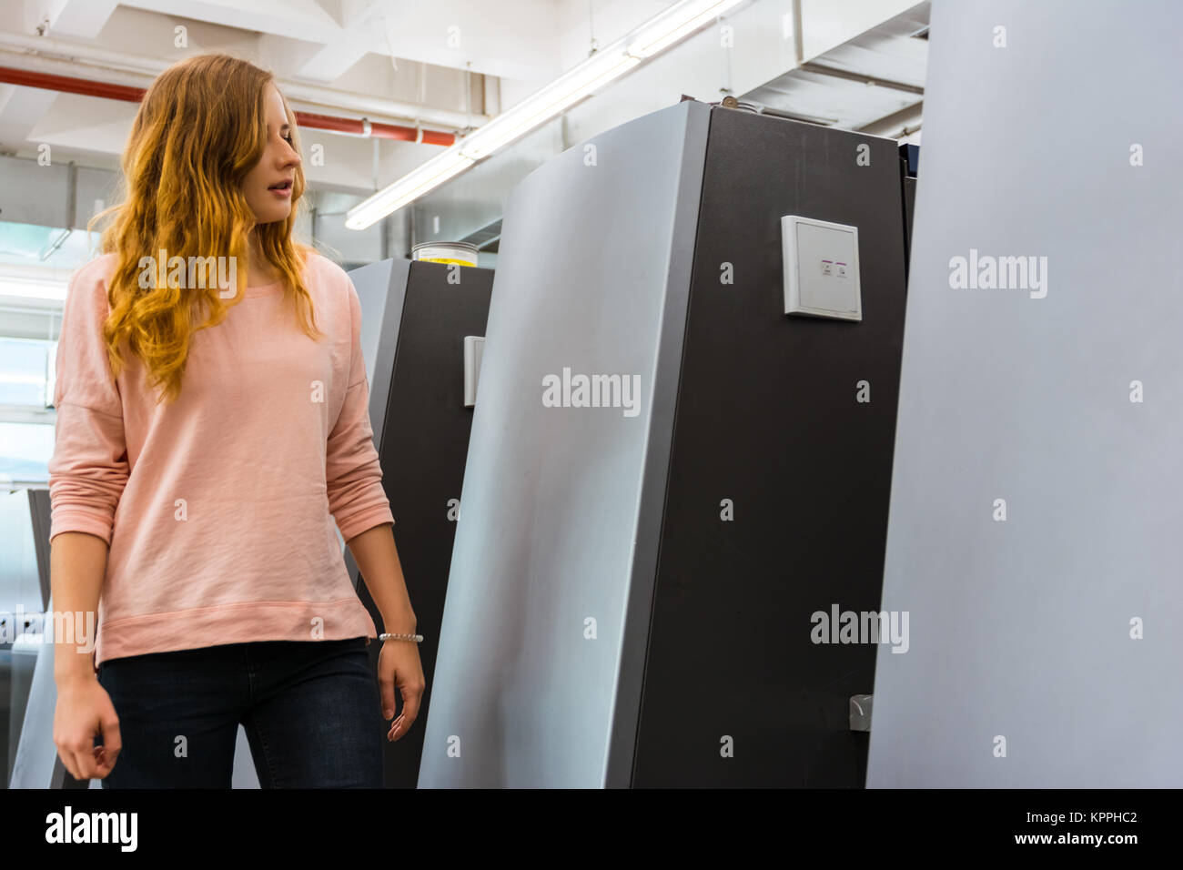Female Engineer Offset Printing Specialist Operating Printer Machine Young Girl Student - Stock Image