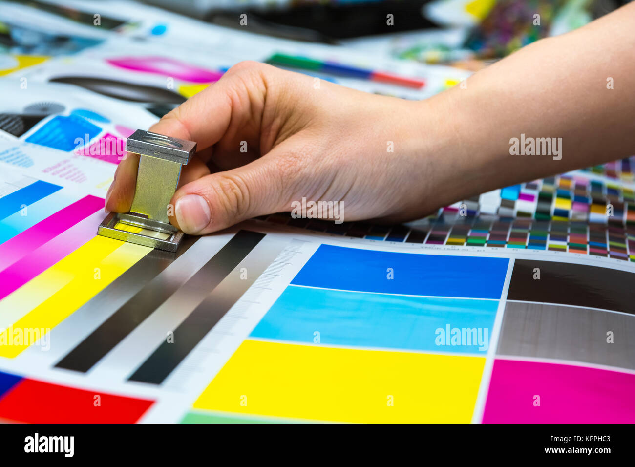 Printing Thread Counter Being Used by Female Hand Measurement Color Management Closeup Industry Object - Stock Image