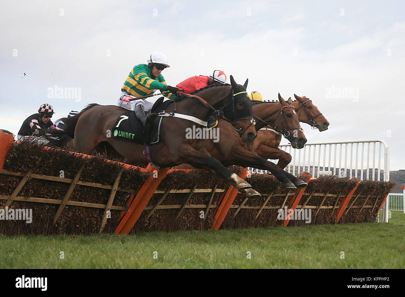 My Tent or Yours (nearside) ridden by Barry Geraghty wins the Unibet International Hurdle Race during day two of - Stock Image