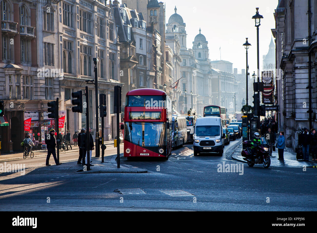 LONDON, UNITED KINGDOM - DECEMBER 12th, 2017: Morning traffic on Whitehall. Whitehall is a road in the City of Westminster, - Stock Image