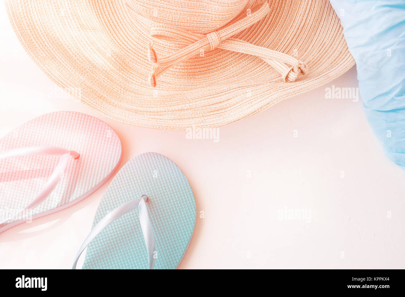 89a3ed2f3 Elegant Female Straw Hat Blue Slippers Beach Wrap on White Background  Golden Pink Flare Pastel Colors Summer Vacation Seaside Minimalist Style  Copy Sp