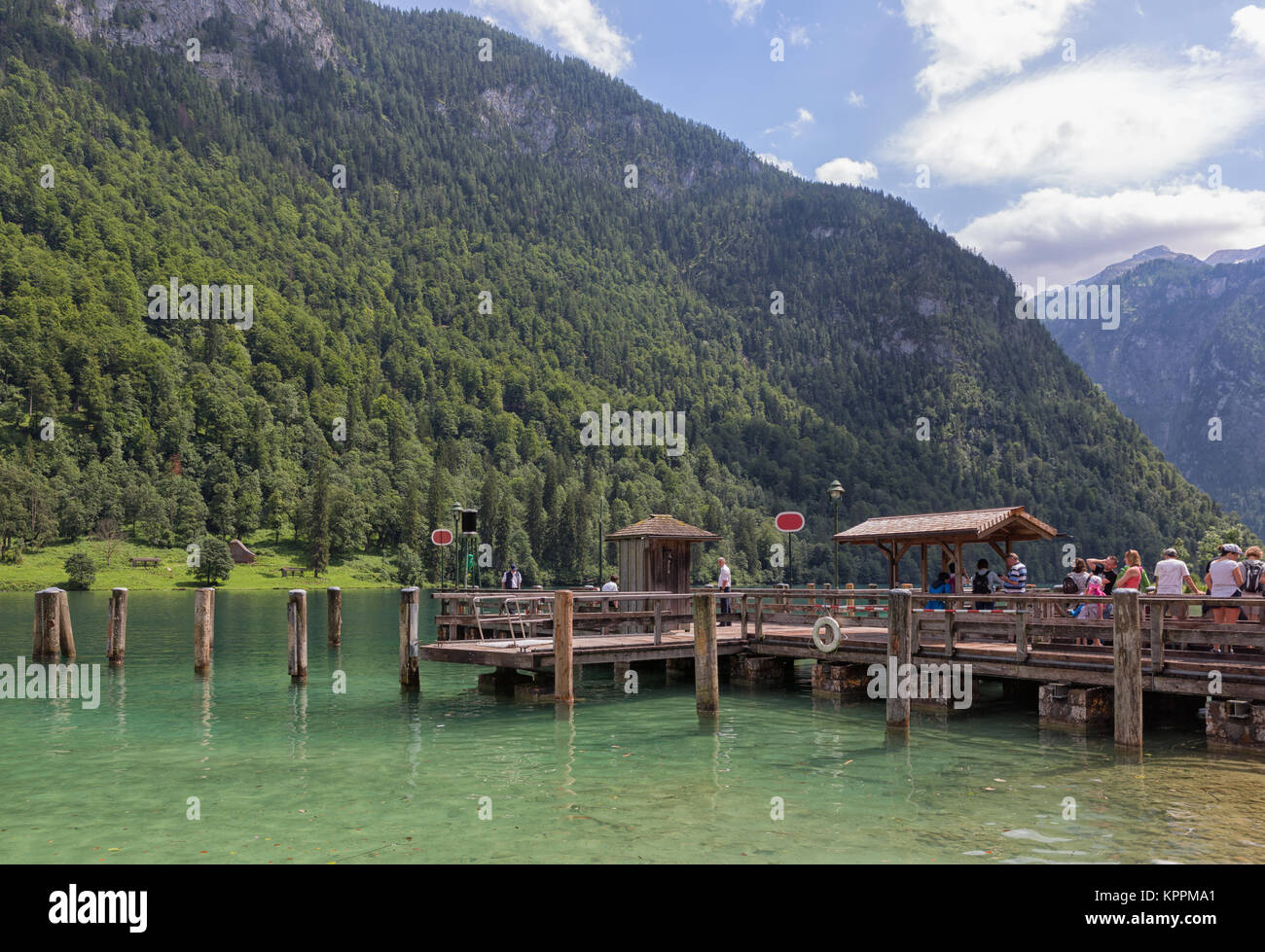 People on pier waiting for launch ship at Konigssee - Stock Image