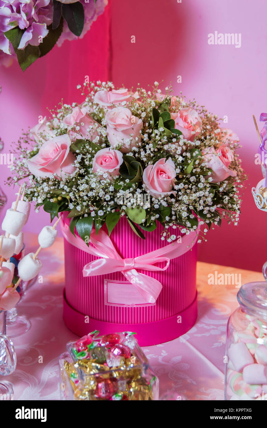 Rounded pink flower bouquet bouquet of delicate pink flowers in rounded pink flower bouquet bouquet of delicate pink flowers in round boxes stairs and chair on the white with lots of bouquets of pink flowers izmirmasajfo