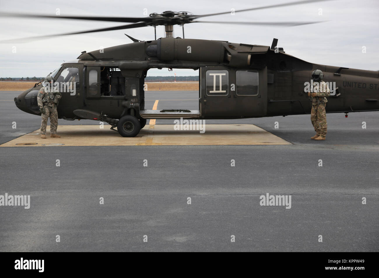 U S Army Reserve UH-60 Blackhawk helicopter pilots stand by their