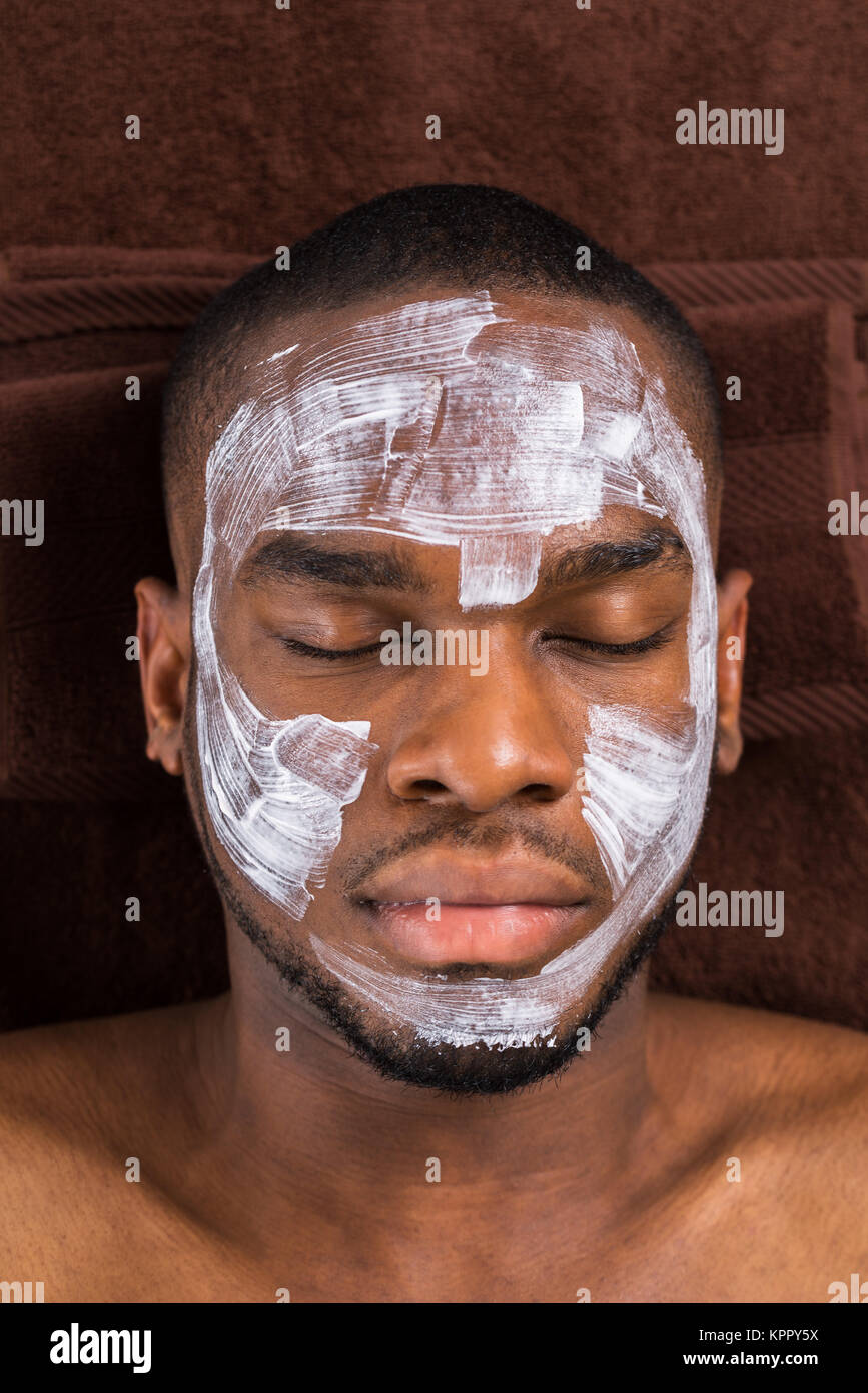 Face Mask Applied To Young Man - Stock Image