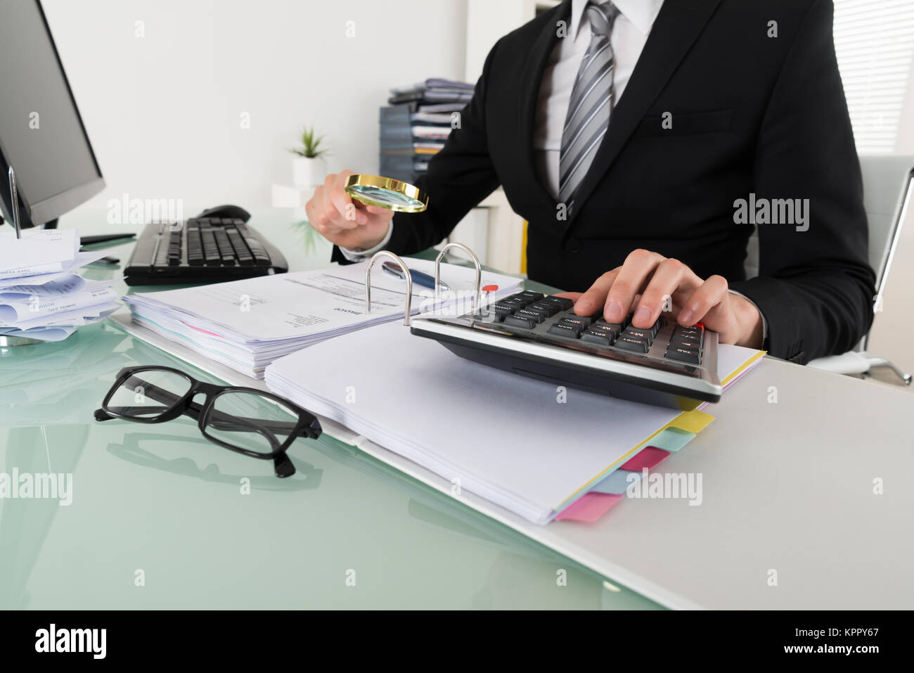 Businessman Analyzing Bills - Stock Image