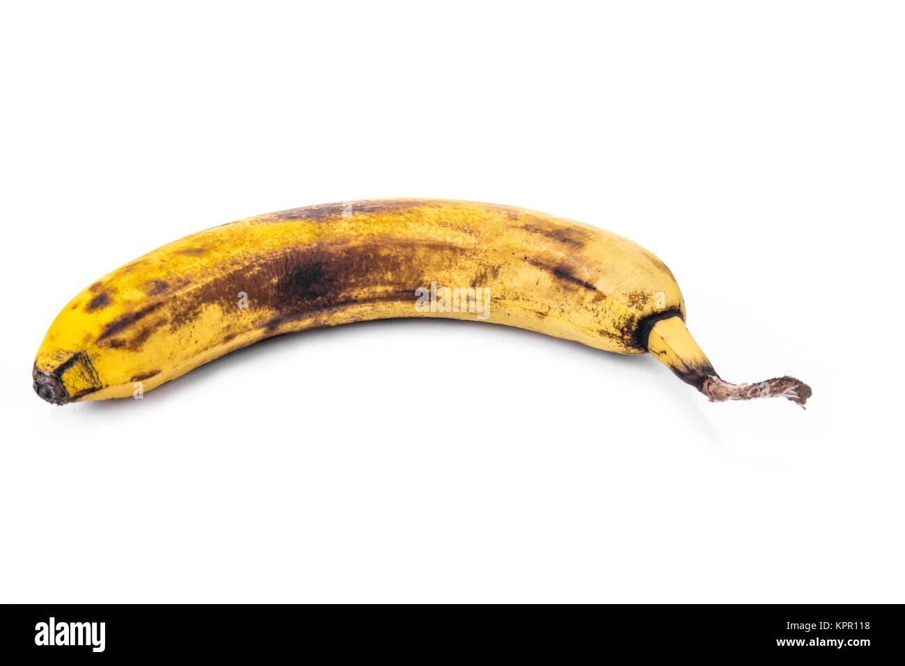Overripe banana on the white background - Stock Image