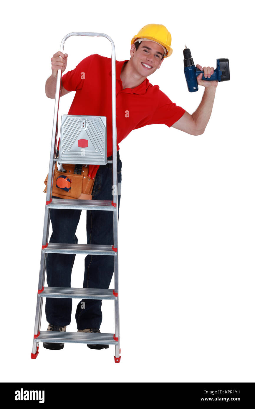 Young carpenter up ladder - Stock Image