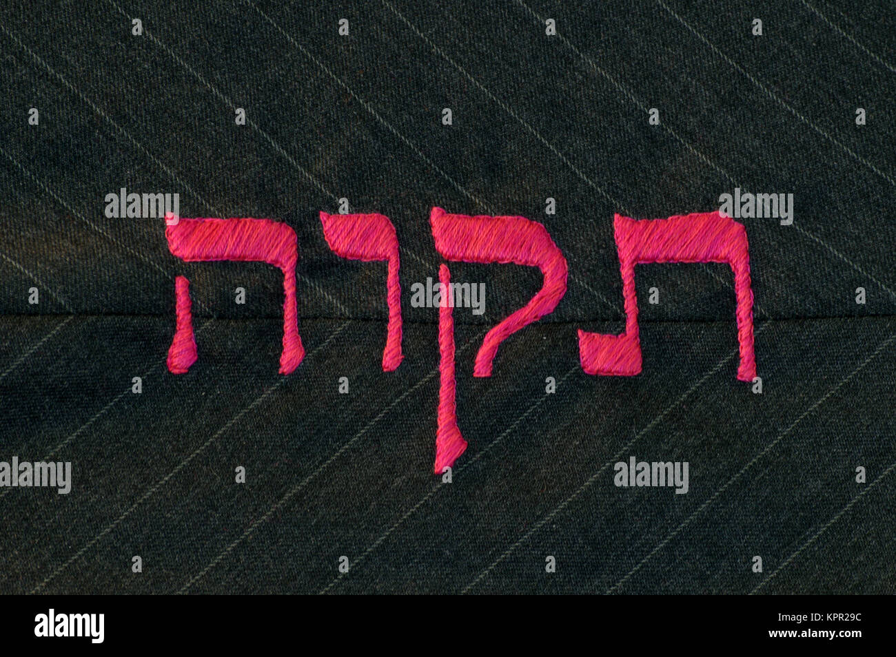 Hope in Hebrew language, stitched on fabric - Stock Image
