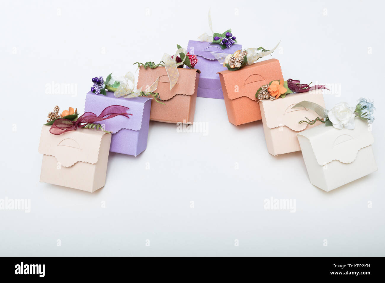 Light colours gift boxes  with flowes and ribbons, on white background copy spaces for text - Stock Image