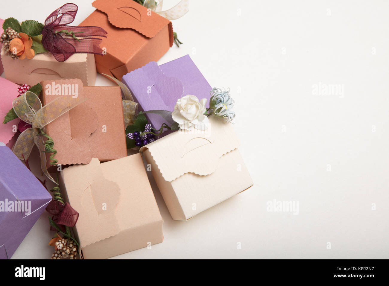 Fancy  carton wedding or  gift boxes with ribbon and flowers with copy spaces , high quality image - Stock Image