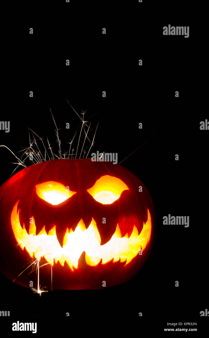 Halloween Pumpkin Carving Face With Sparkler Stock Photo