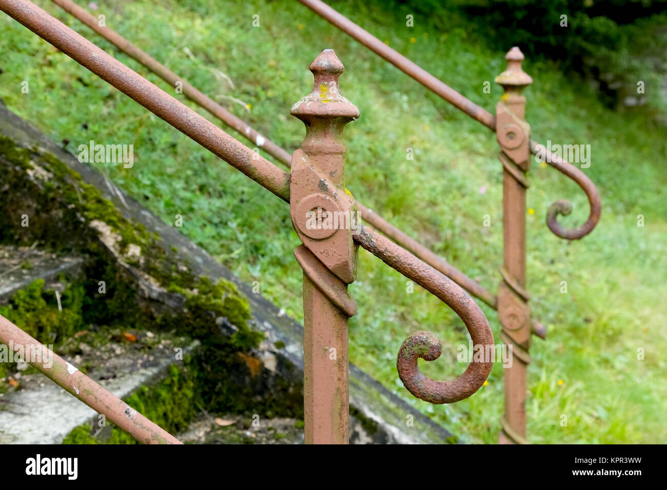 Old handrail with forgotten and abandoned stairs - Stock Image