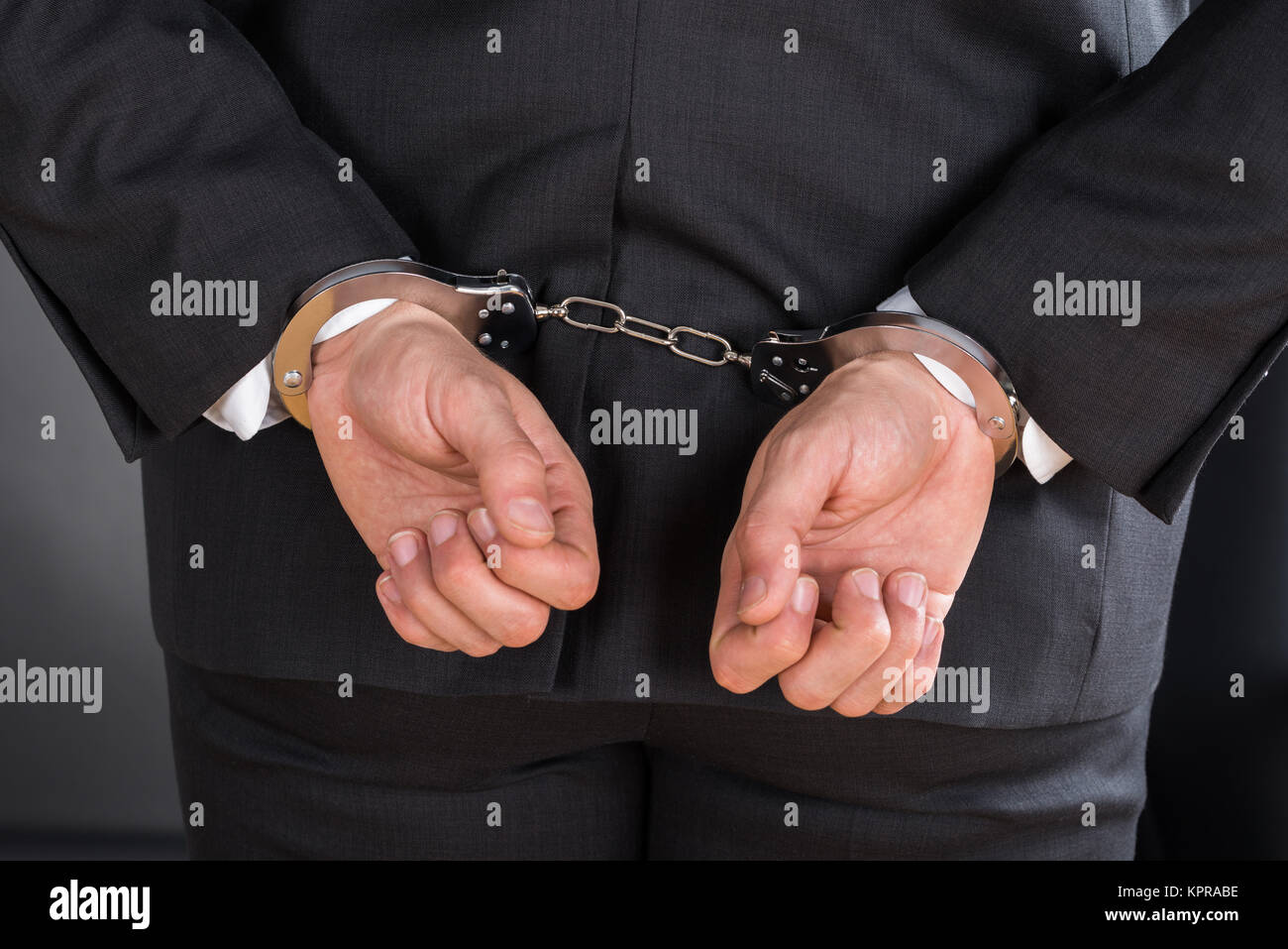 Close-up Of Businessman In Handcuffs - Stock Image