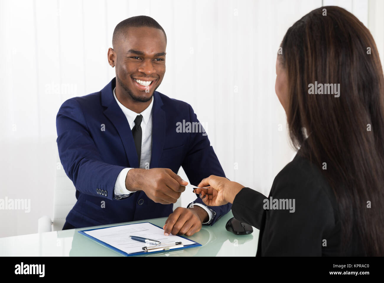 Business Executive Exchanging Business Card - Stock Image