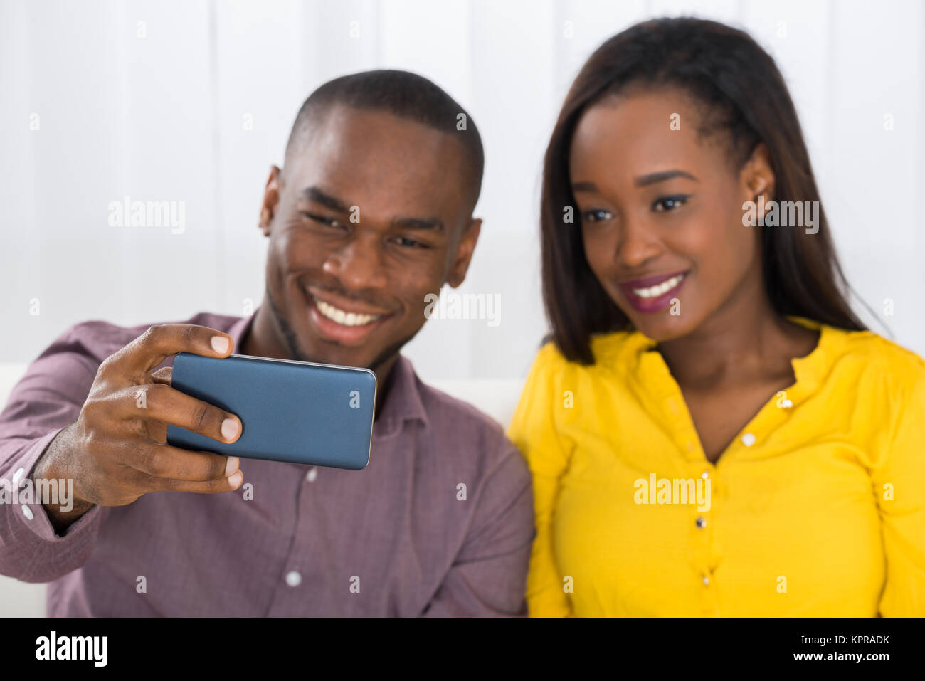 Couple Taking A Selfie With Mobile Phone - Stock Image