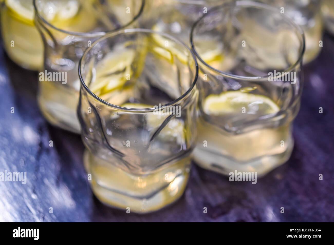 Many alcoholic drinks with lemon Stock Photo