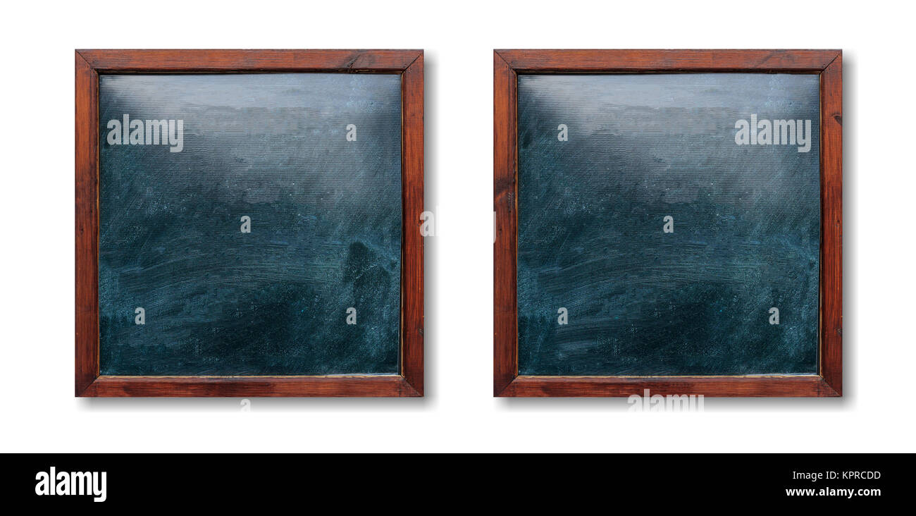 Blank wooden frames on the wall. Blackboards inside and white background, space for text. - Stock Image