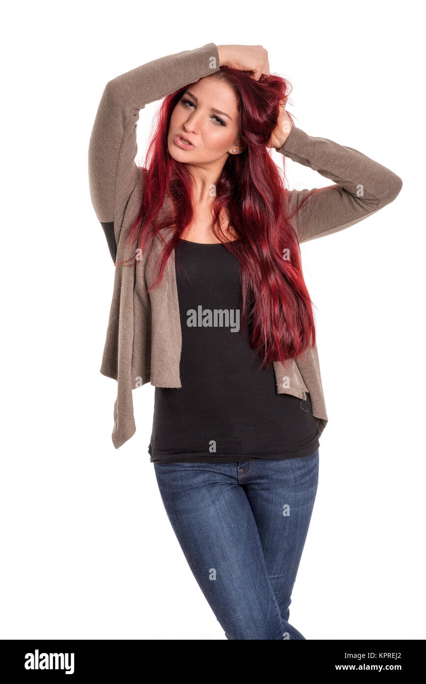 red-haired woman wuschelt at loggerheads - Stock Image