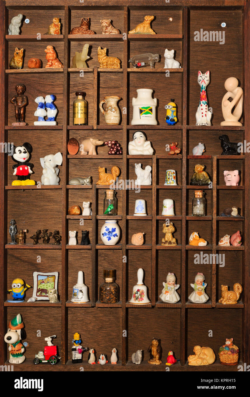 Wooden German print box display with small objects and trinkets. - Stock Image