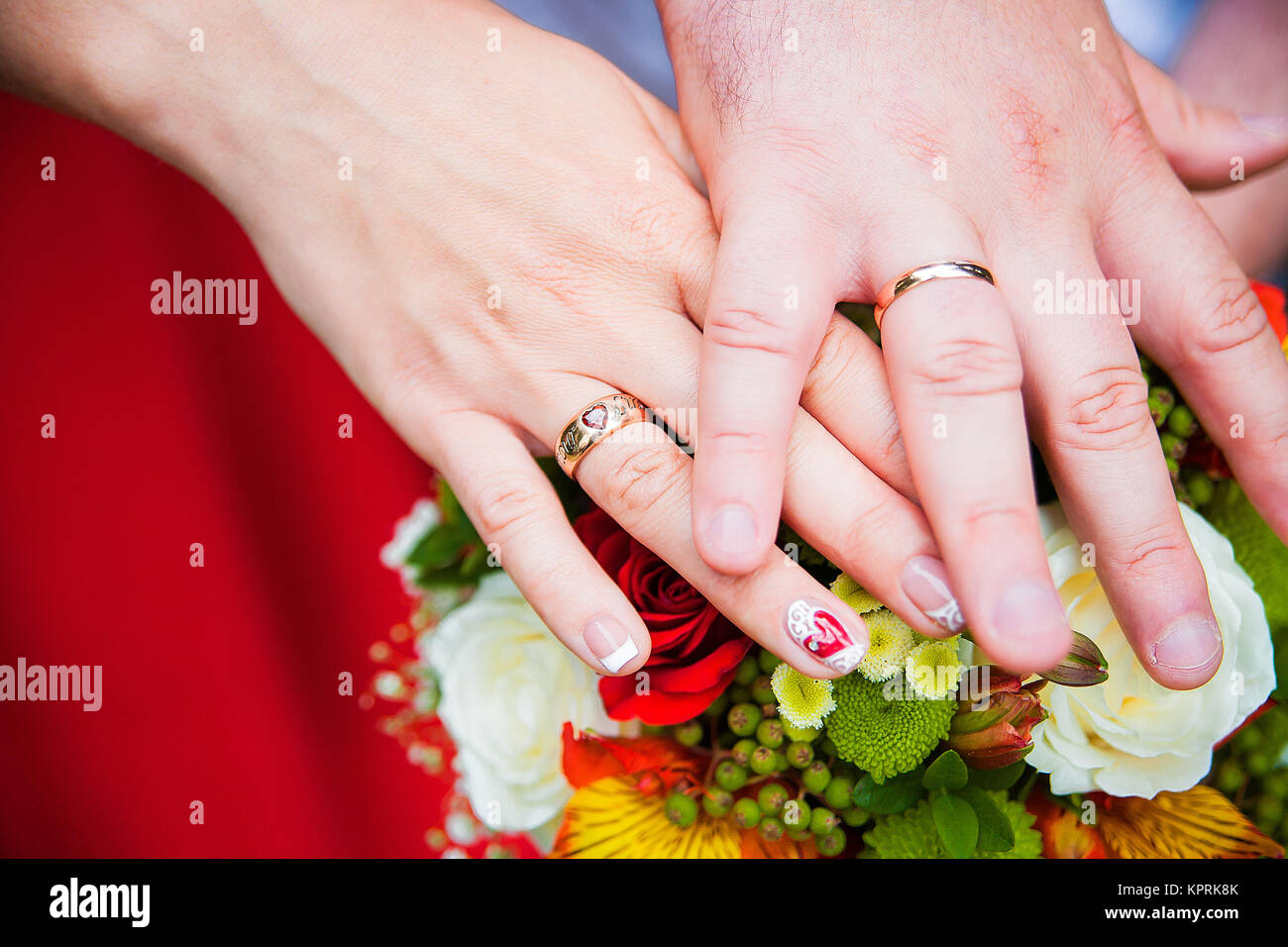 Bride and groom with wedding rings on hands Stock Photo: 168935779 ...