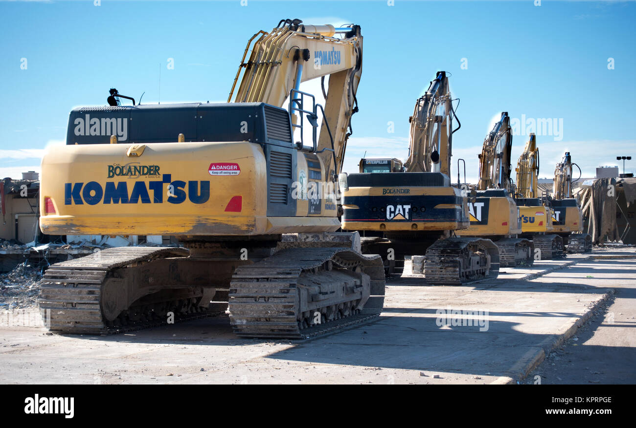 Row of track driven excavators at the construction site of the new Minnesota United FC professional soccer stadium. - Stock Image