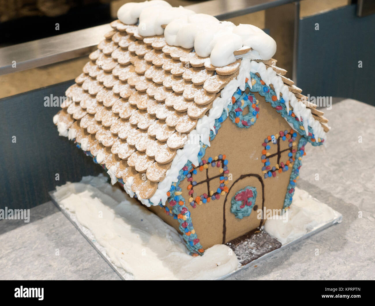 Gingerbread house decorated for the holiday season with heart cookie roof and frosting. St Paul Minnesota MN USA Stock Photo