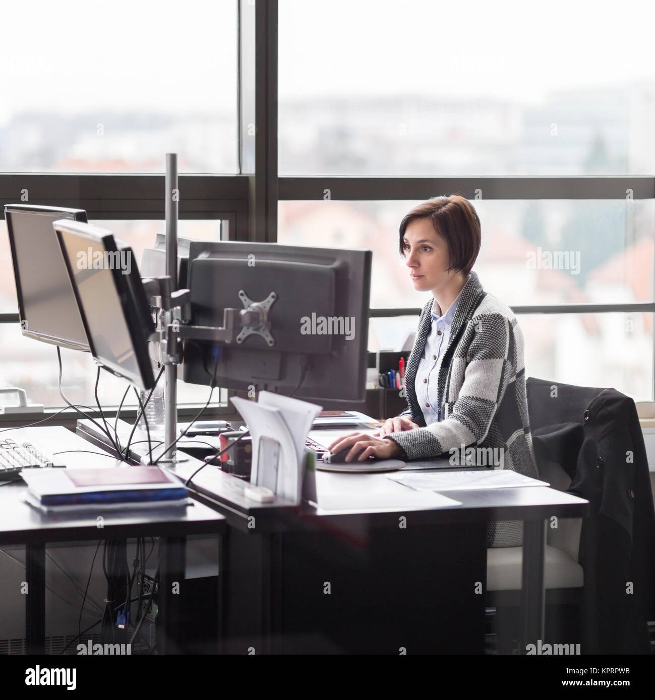 Business woman working in corporate office. - Stock Image