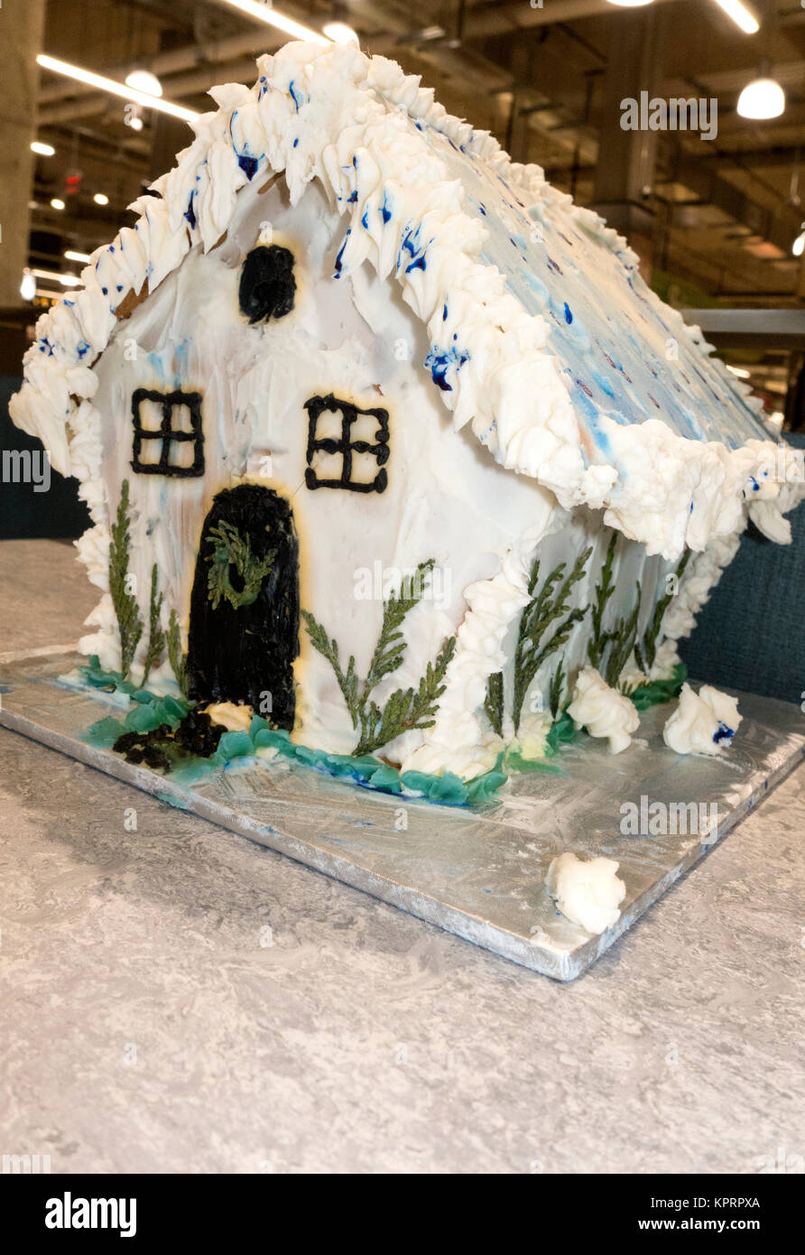 Gingerbread house decorated with lots of frosting and accent greenery for the holiday season. St Paul Minnesota Stock Photo
