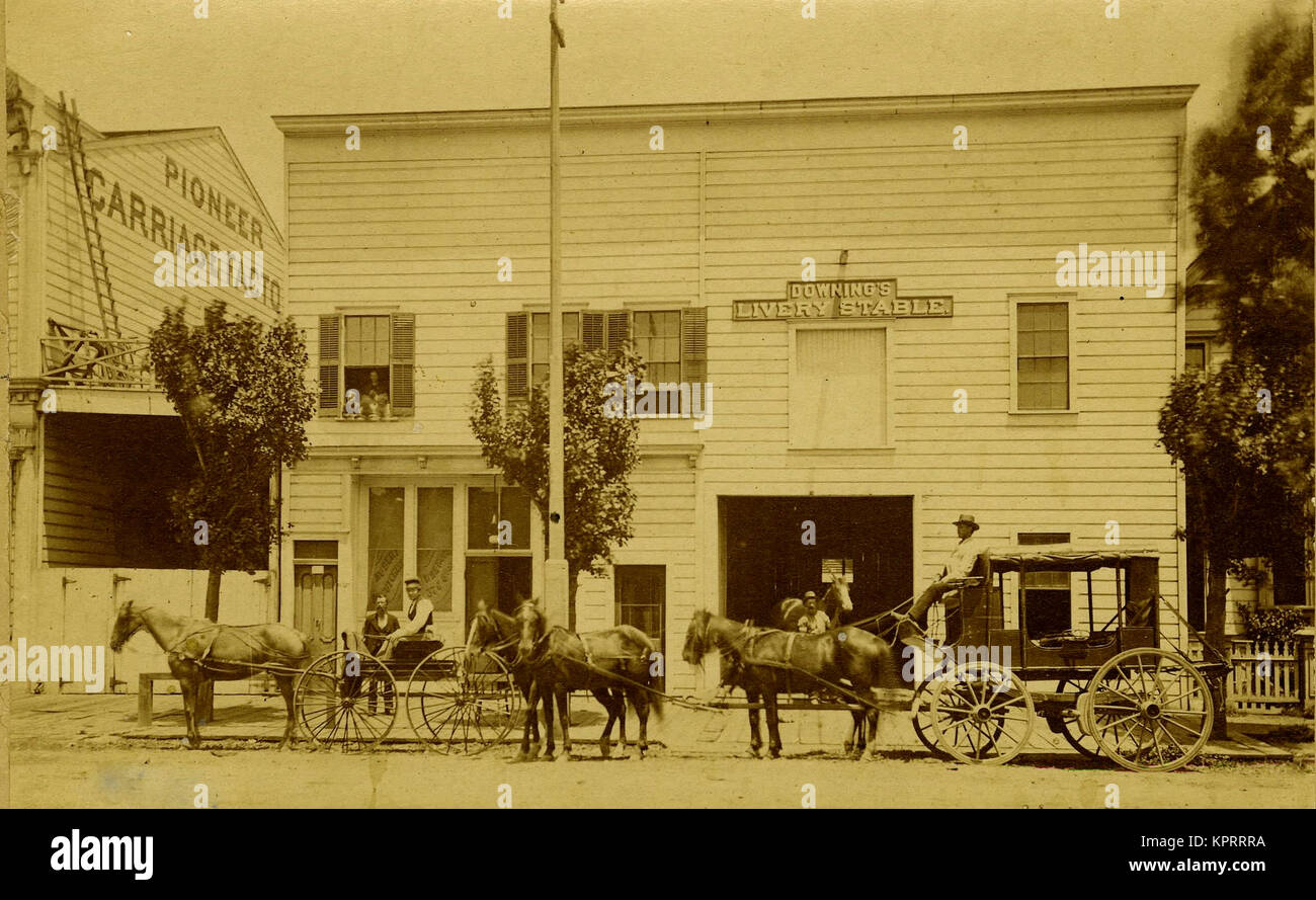 Mud Wagon/ Stagecoach In Front Of The Downing Livery Stable, Next To The Pioneer Carriage Factory - Stock Image