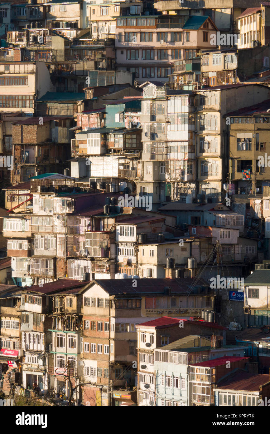Tiered houses and ramshackle buildings on steep hillside in Shimla, India Stock Photo