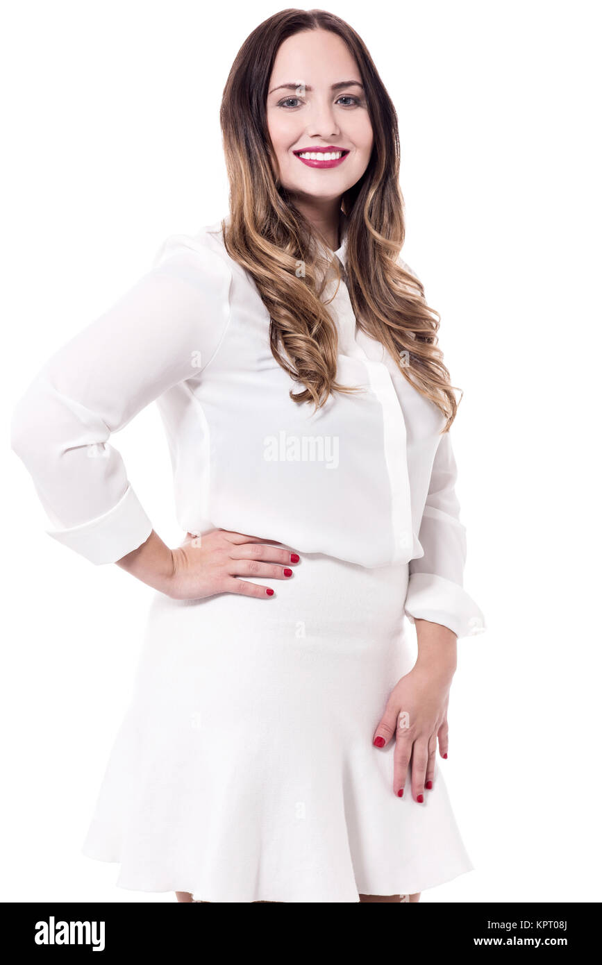 Fashionable woman in a white dress - Stock Image