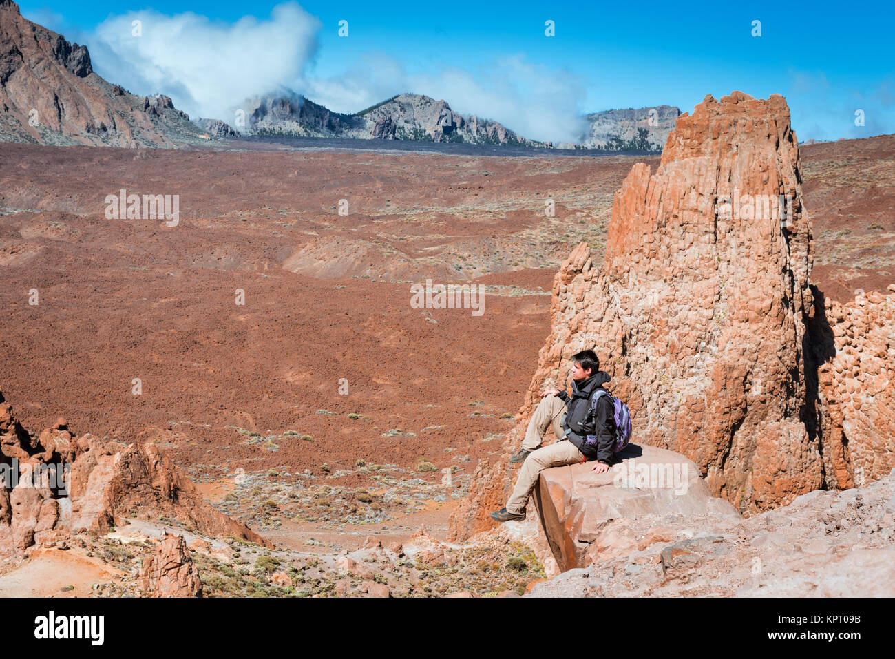 Hiker man hiking Teide national park Tenefire - Stock Image
