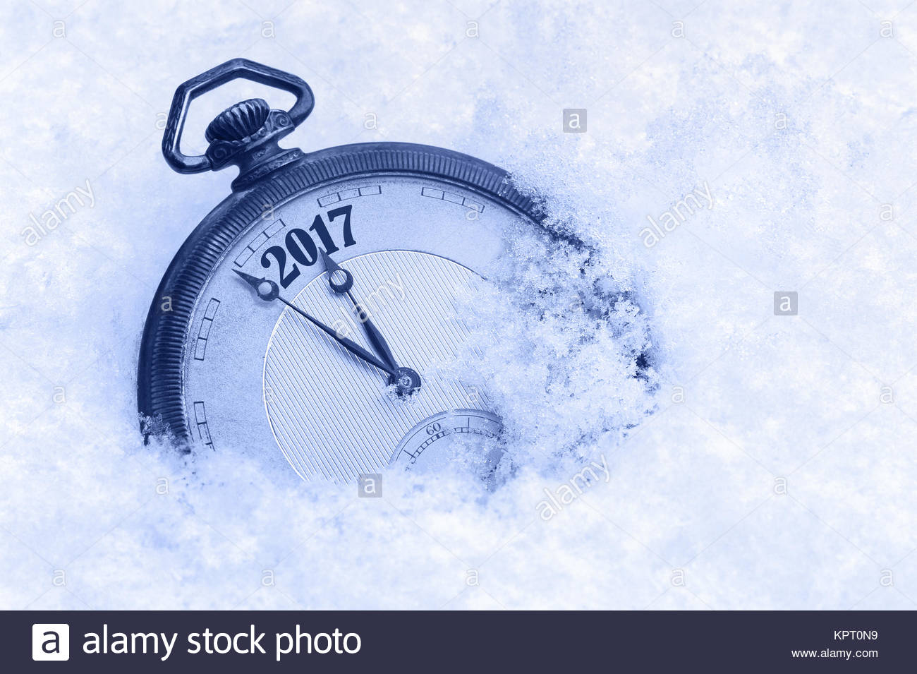 New Year 2017 greeting card, 2017 new year, pocket watch in snow, happy new year concept Stock Photo