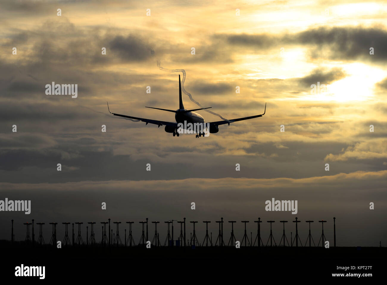 Ryanair Boeing 737 airliner jet plane landing at London Stansted Airport at sunset. Dusk. Evening. Passing over - Stock Image