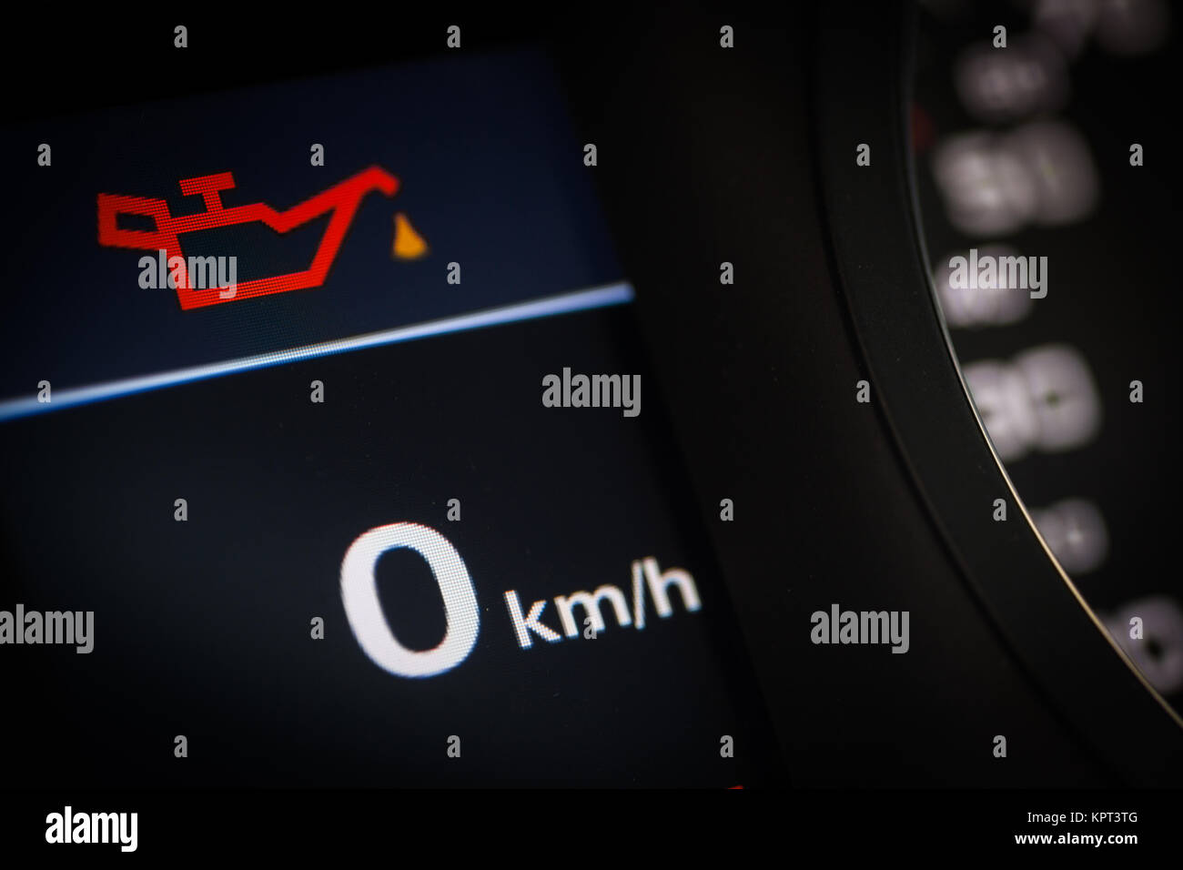 Color Detail Of The Oil Warning Symbol In A Car Stock Photo