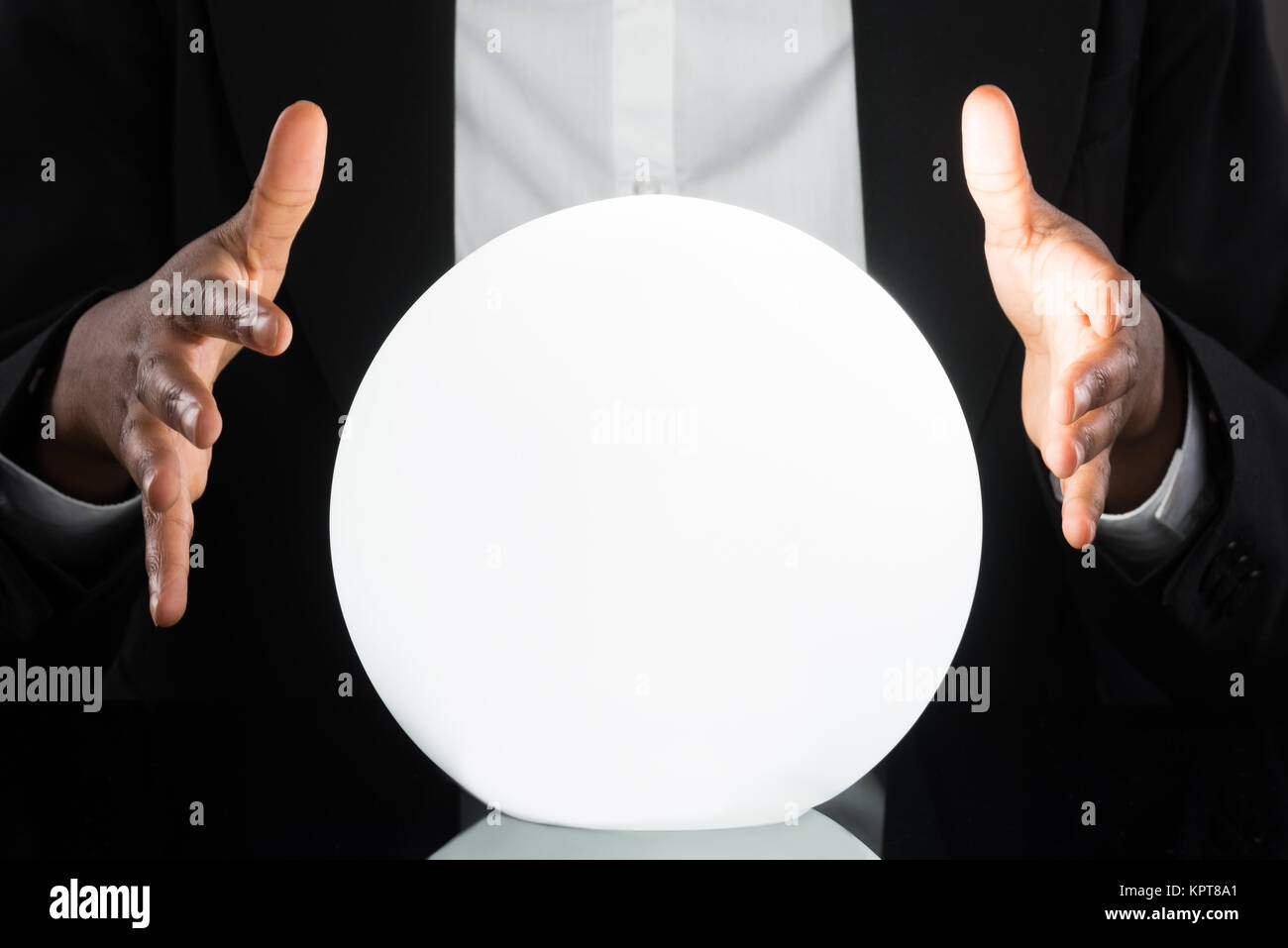 Businessperson Predicting Future With Crystal Ball - Stock Image