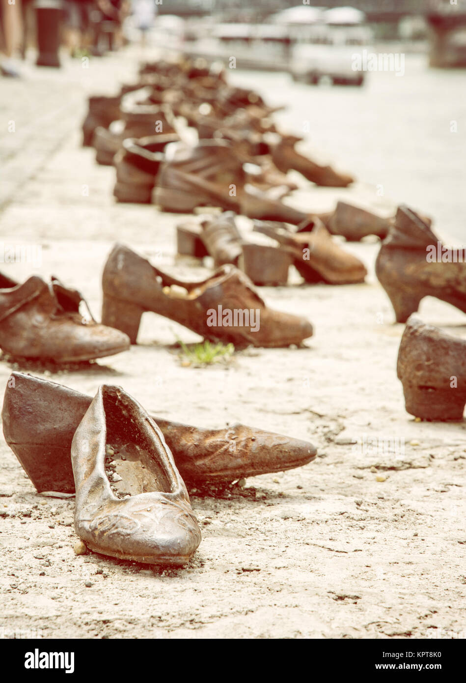 Shoes monument on the Danube bank is a memorial in Budapest, Hungary. Place of reverence. Symbolic object. Yellow - Stock Image