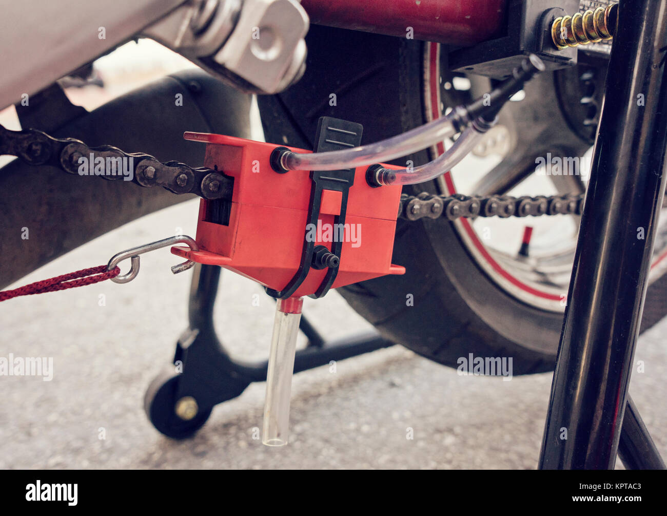General view of motorcycle manual chain service - Stock Image