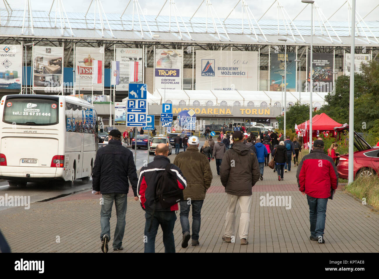 Speedway supporters making their way to the Motoarena Torun Poland  for the Polish speedway grand prix - Stock Image