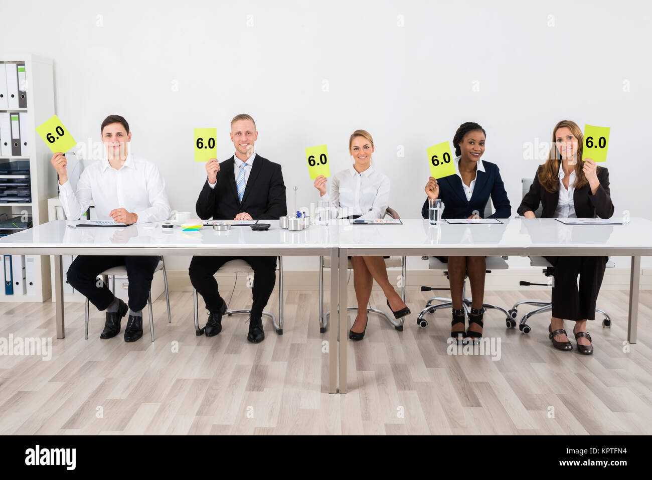 Businesspeople Holding Voting Paper - Stock Image