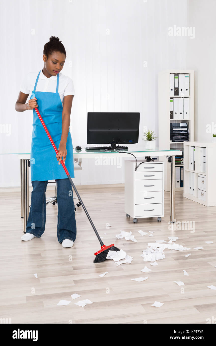 black woman sweeping high resolution stock photography and images alamy https www alamy com stock image female janitor sweeping hardwood floor 168955131 html