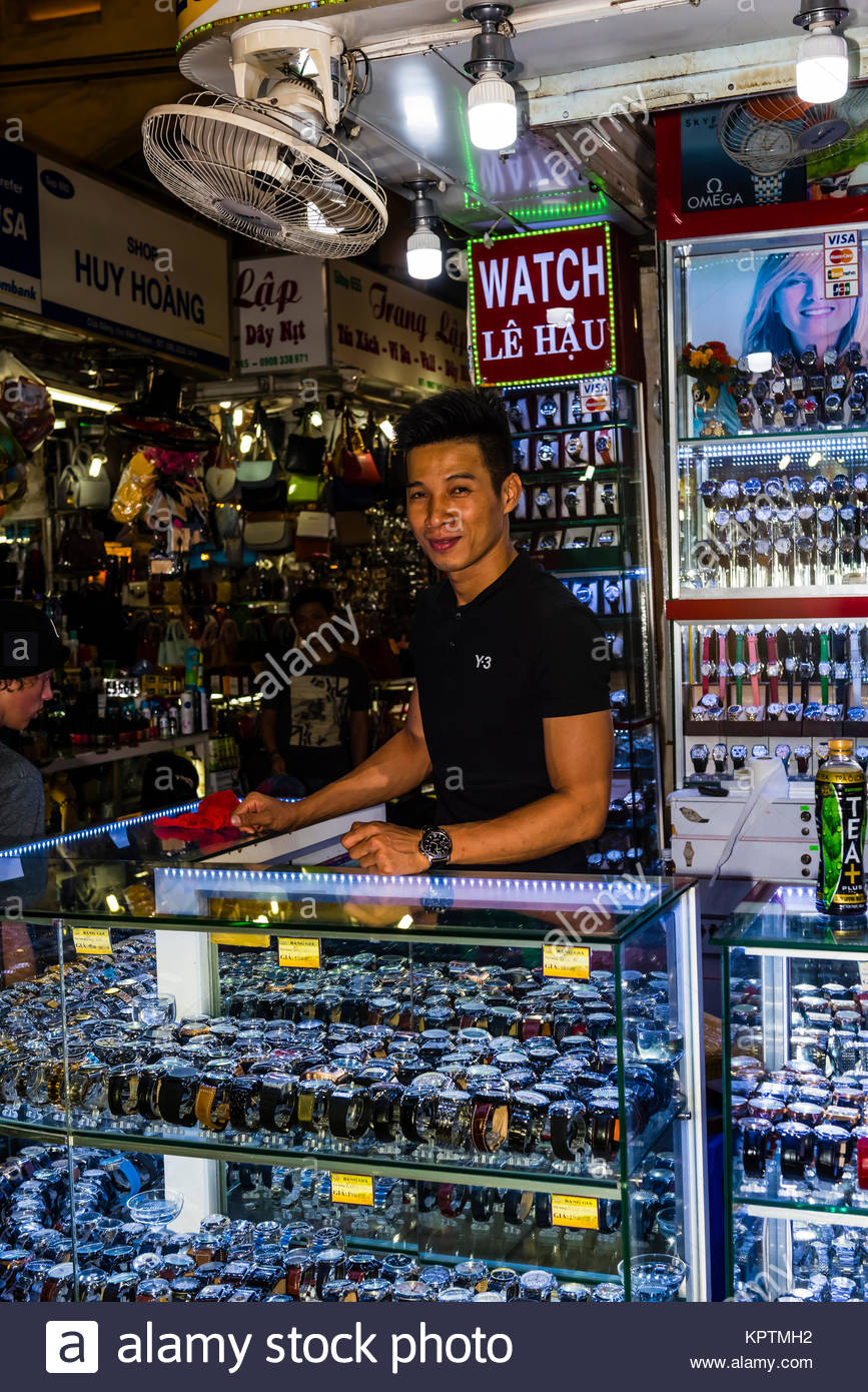Merchant selling watches in the Ben Thanh Market, Ho Chi Minh City (Saigon), Vietnam. - Stock Image