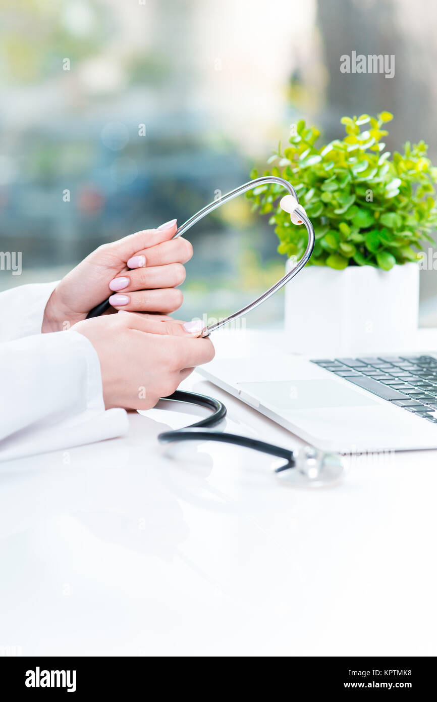 Doctor with a stethoscope in the hands - Stock Image