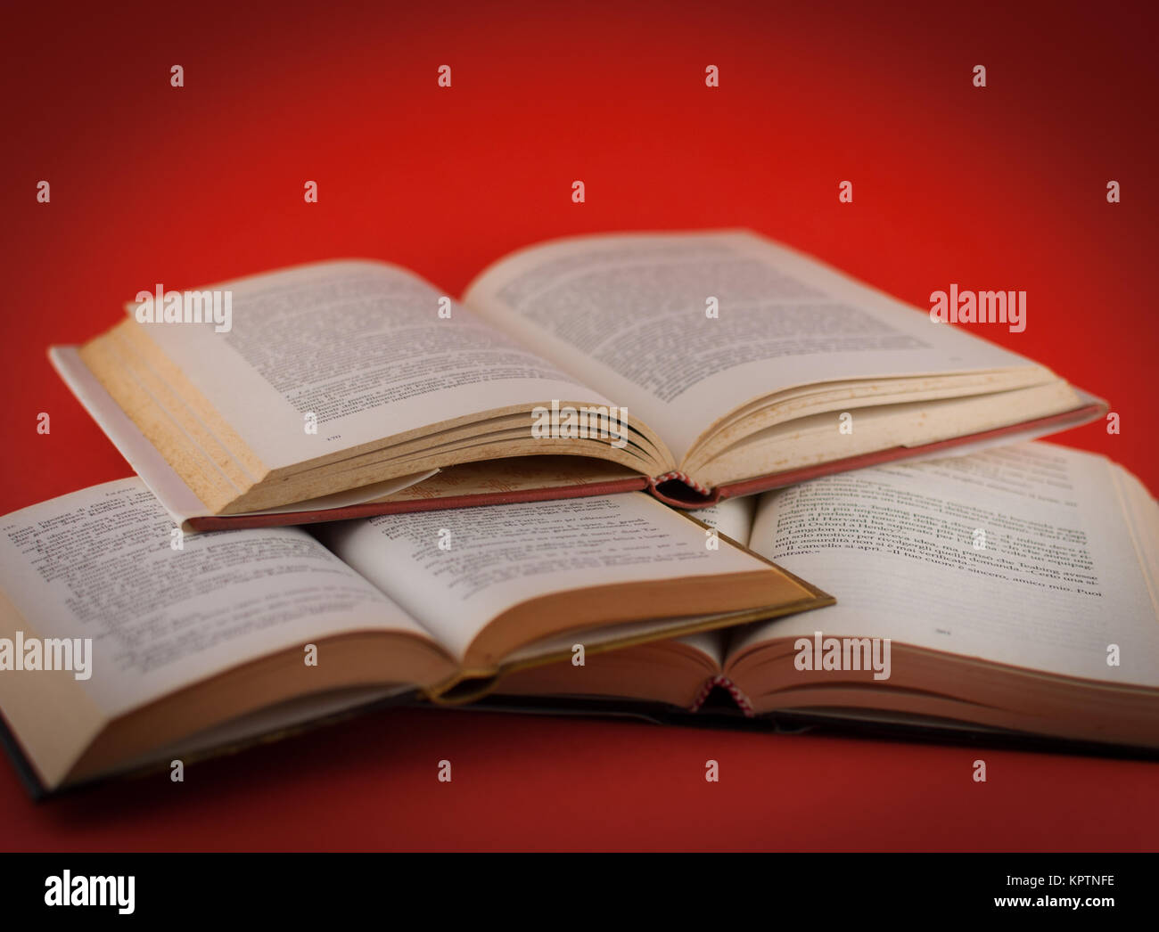 closeup of open books on colored background Stock Photo
