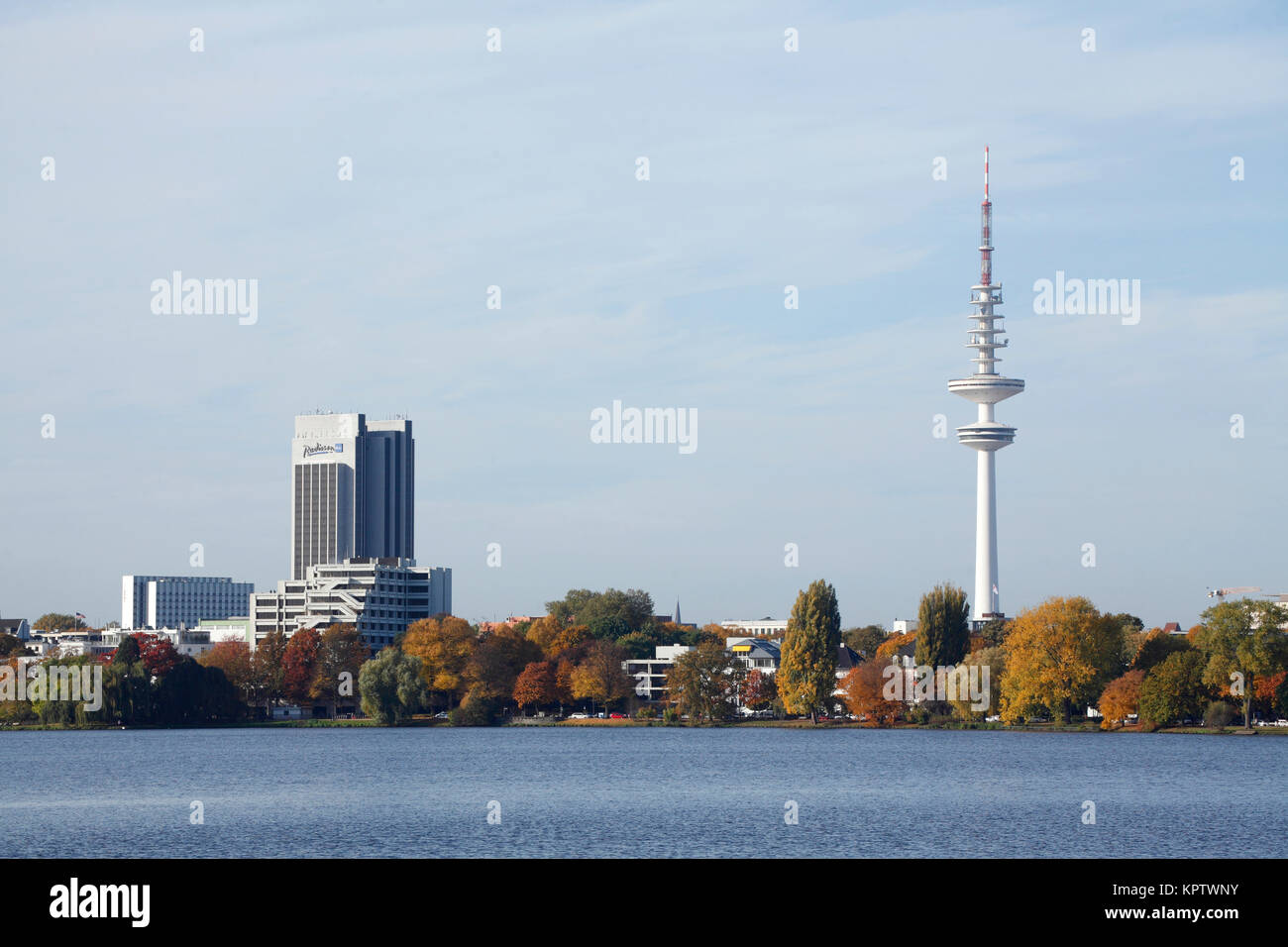 Radisson Blu Hotel and TV tower, at the Außenalster in autumn, Hamburg, Germany - Stock Image