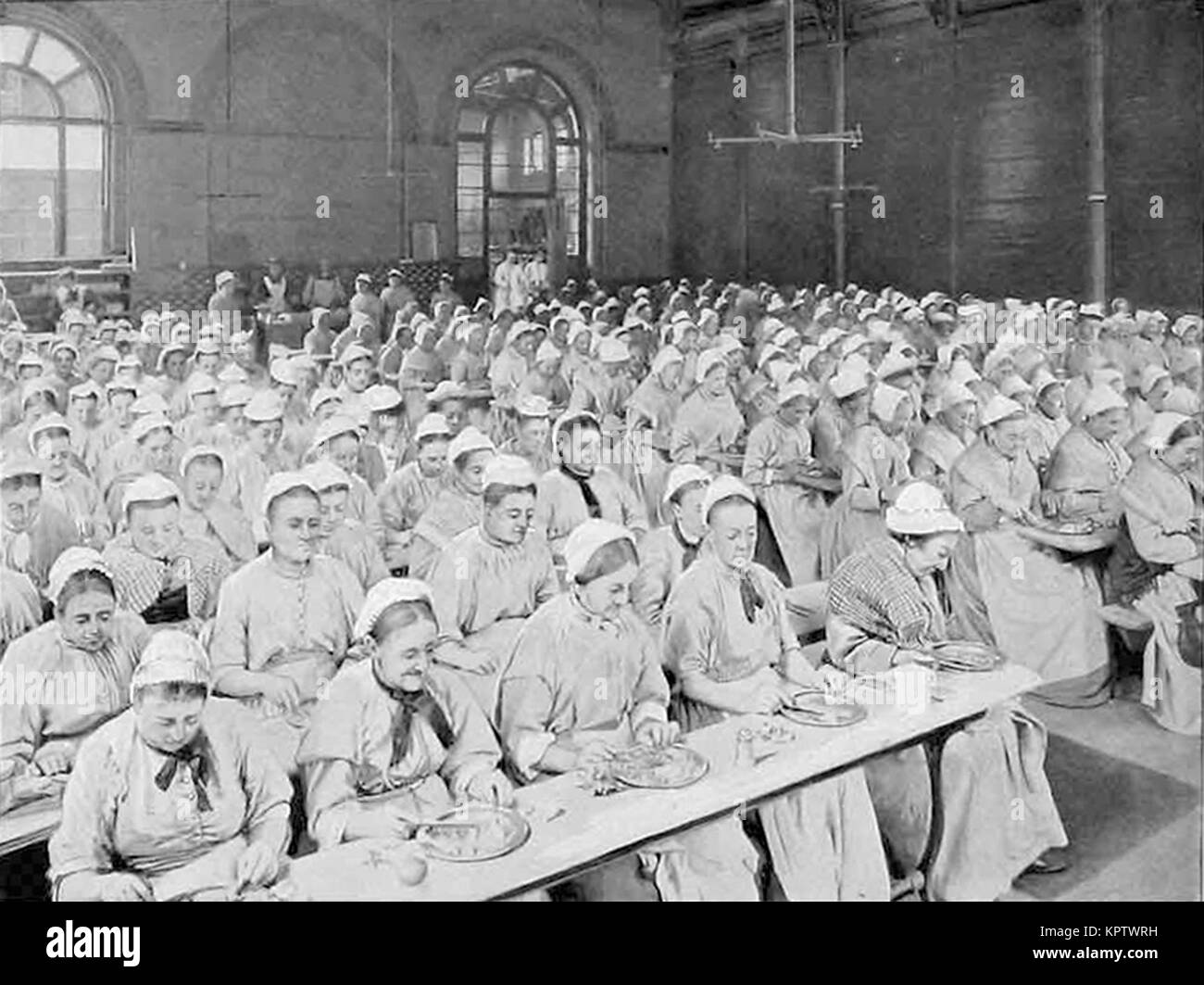 Dinnertime at St Pancras Workhouse, London - Stock Image