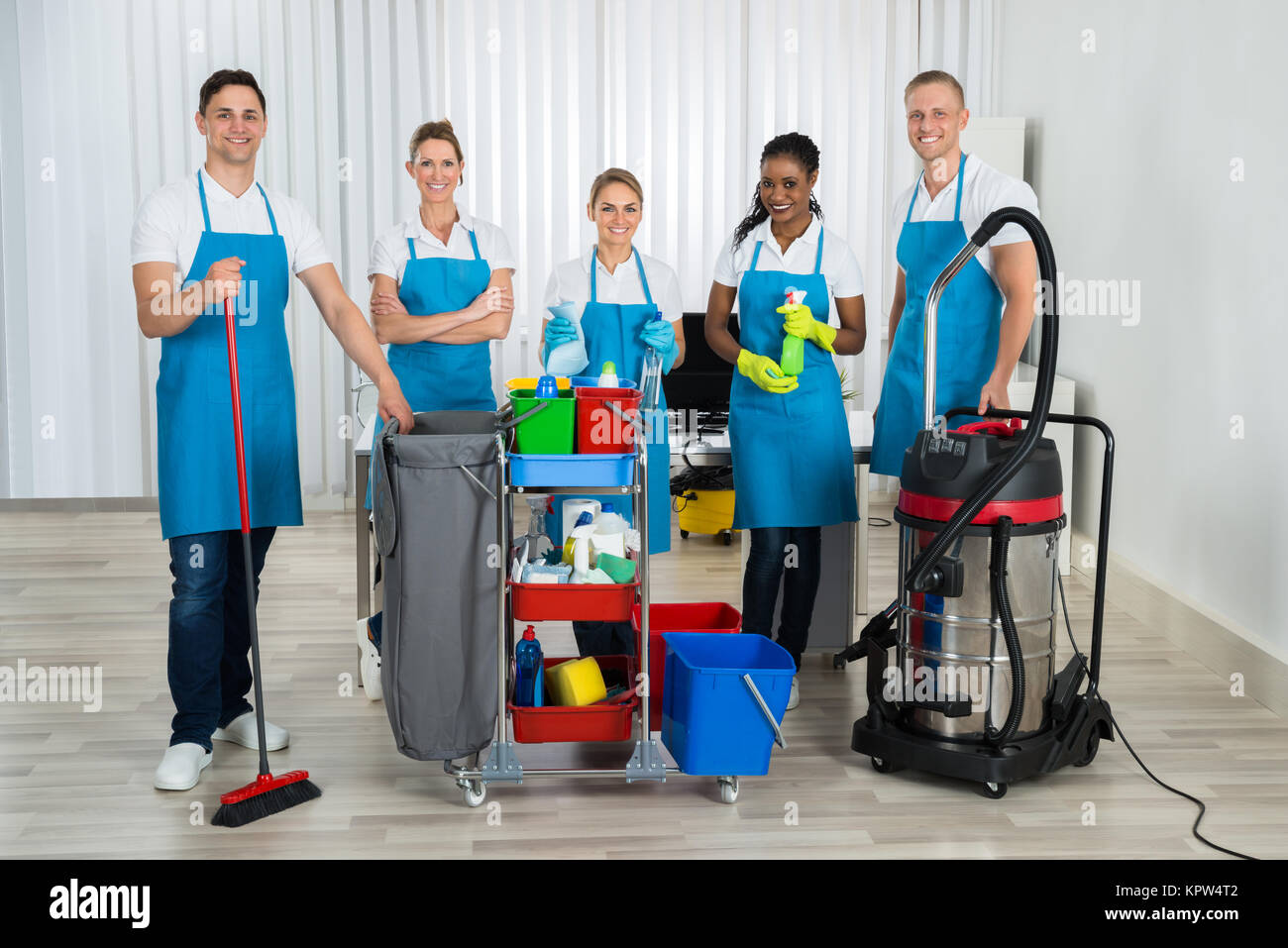 Cleaners With Cleaning Equipments In Office - Stock Image